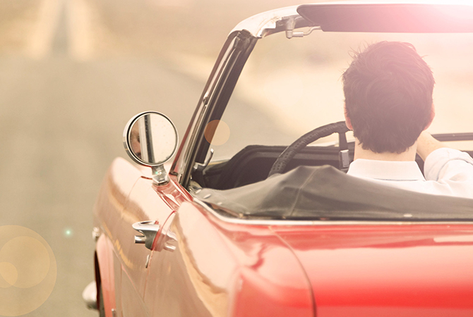 man driving convertable
