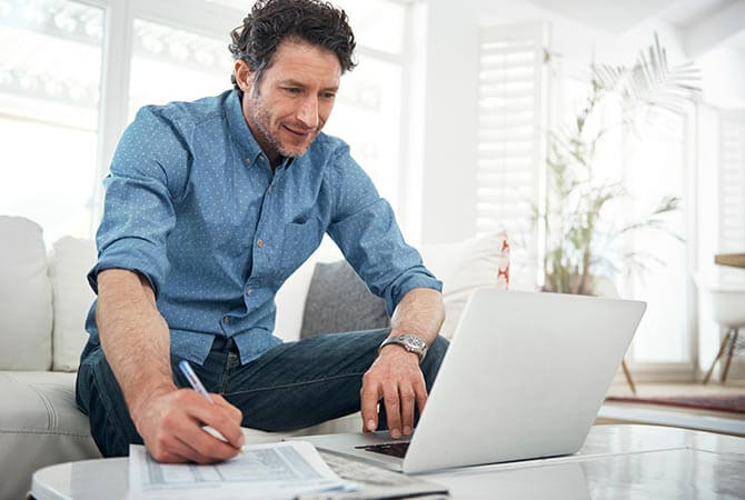 man in living room using a laptop