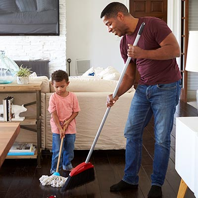 Man and son cleaning their house
