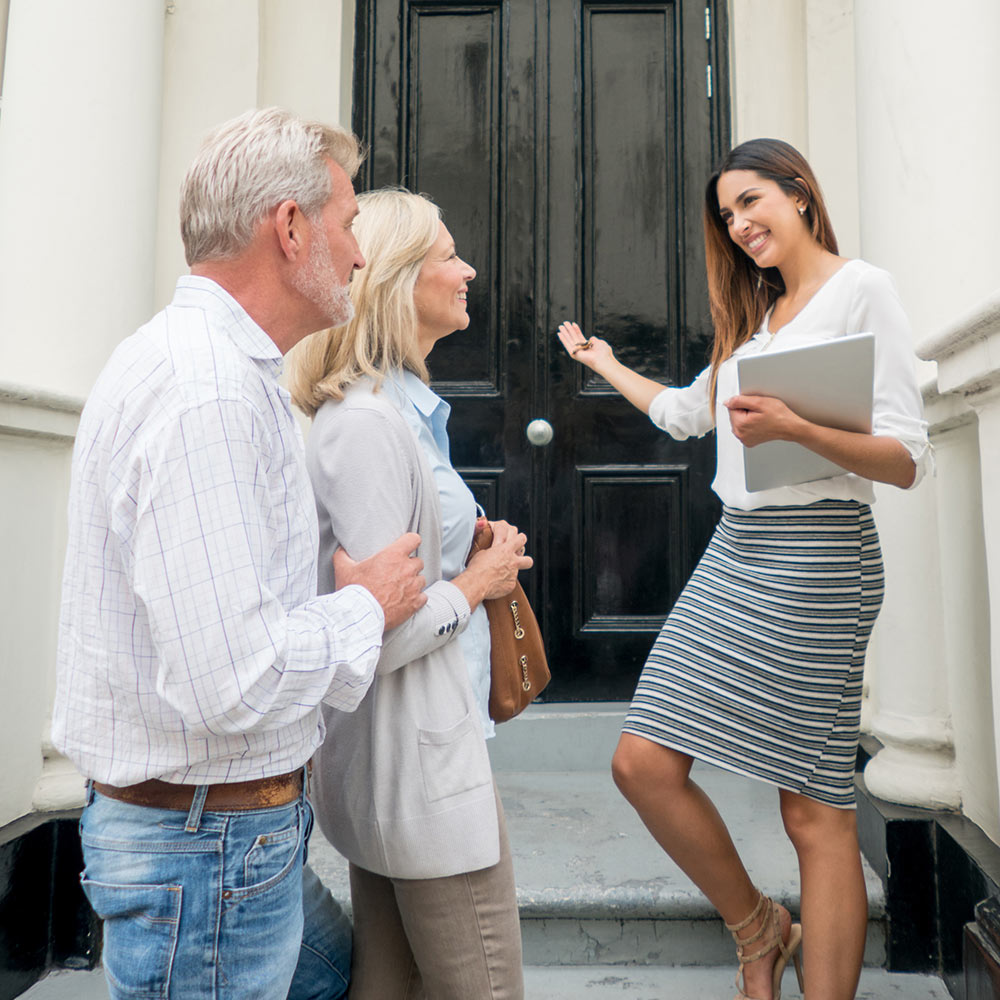 Realtor showing older couple a home