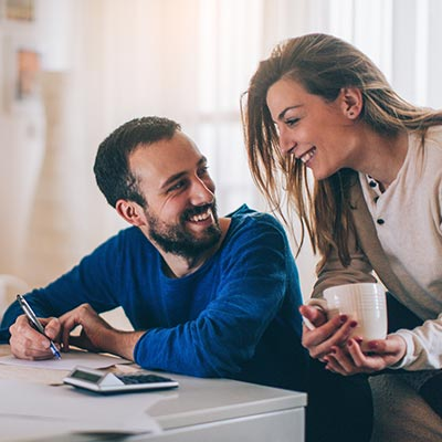 Young couple writing financial resolutions for 2019