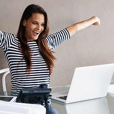 Happy woman using online banking