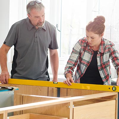 Father and daughter rebuilding kitchen