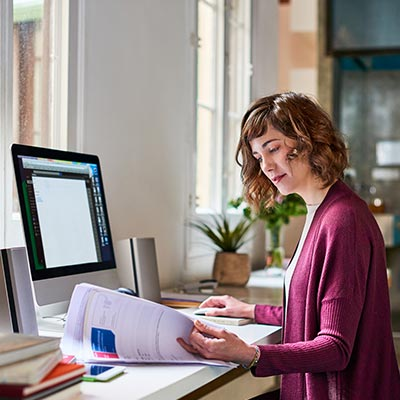 Woman organizing her important financial documents at home